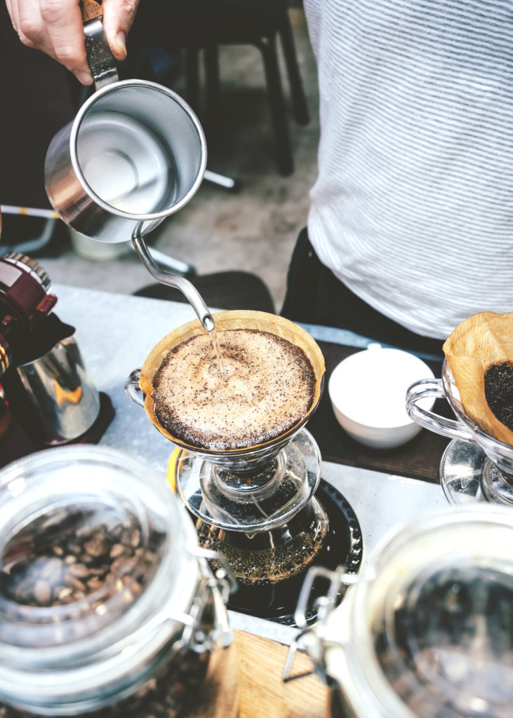 Barista pouring water on Drip coffee